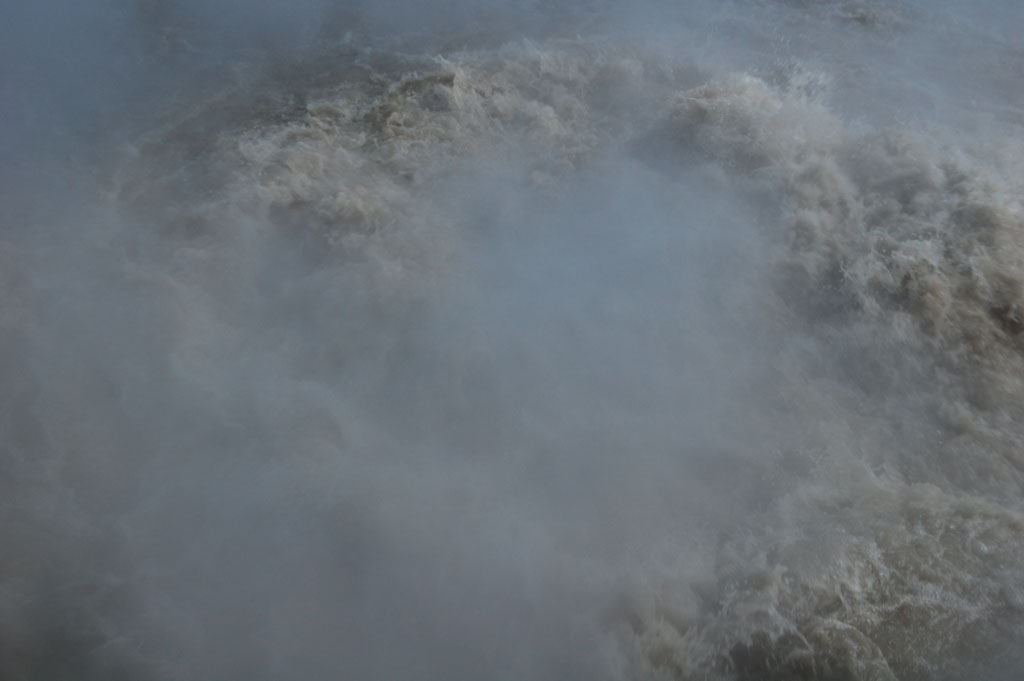 Steam rising from Churning Caldron in the Mud Volcano area in Yellowstone National Park